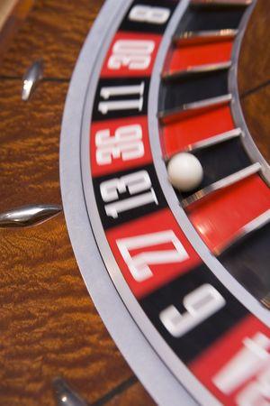 gambling parlour: Roulette game wheel (close upblur)
