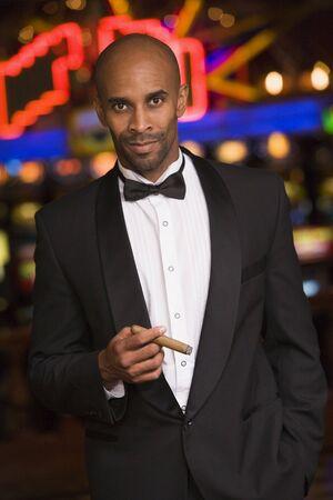 gambling parlors: Man in casino smoking cigar (selective focus) Stock Photo