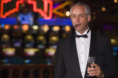 gambling parlors: Man in casino with cigar and champagne (selective focus)