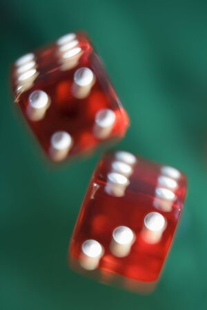 gambling parlors: Dice rolling on a poker table (close upblur)