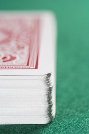 parlours: Deck of cards on a poker table (close upselective focus)