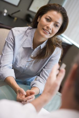 listeners: Woman in consultation at IVF clinic (selective focus) Stock Photo
