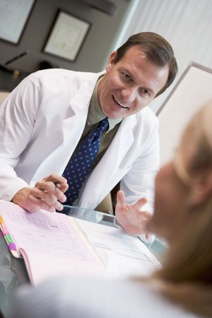 color consultation: Doctor in consultation with woman at IVF clinic (selective focus) Stock Photo