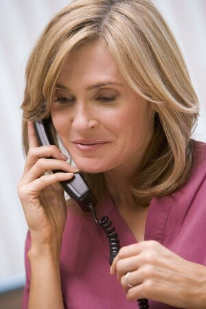Consultant phoning client with good news photo