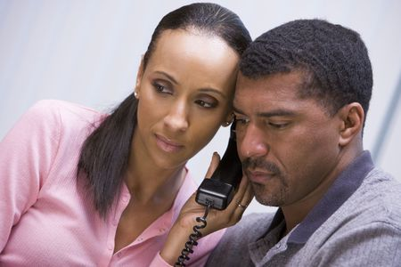 Couple receiving a bad news phone call from clinic photo