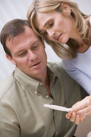 Couple with pregnancy test upset photo