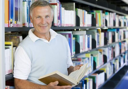 Man in library holding book (depth of field) Stock Photo - 3174788