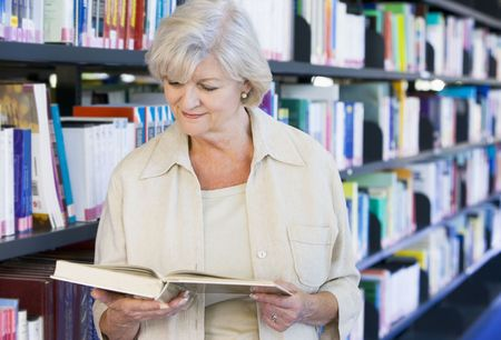 Woman in library reading book (depth of field) photo