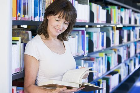 Woman in library reading book (depth of field) Stock Photo - 3174750
