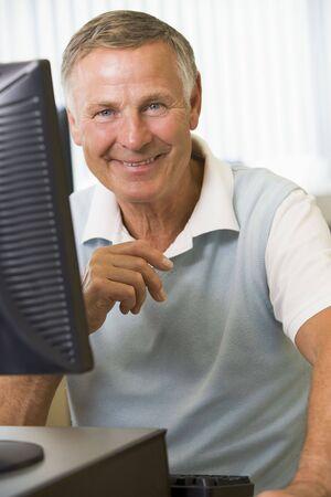 Man sitting at a computer terminal (high key) Stock Photo - 3174305