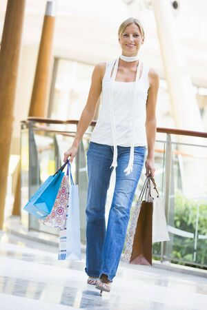 Woman with shopping bags at a shopping mall Stock Photo - 3197953