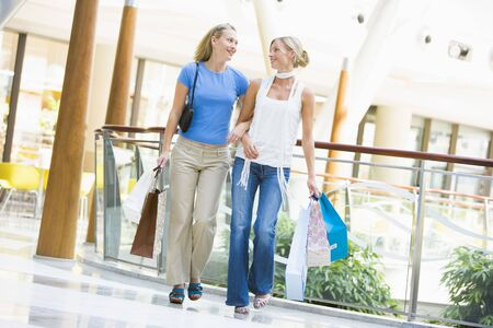 Two women at a shopping mall Stock Photo - 3198043