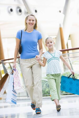 shopping scenes: Mother and young daughter at a shopping mall