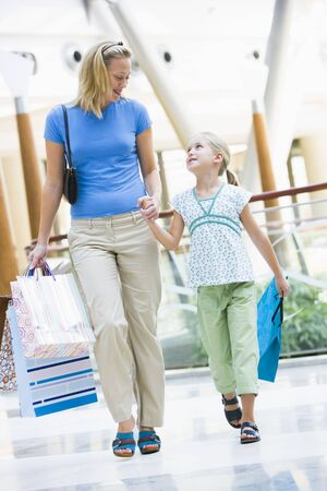 blonde mom: Mother and young daughter at a shopping mall