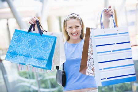 shopping malls: Woman with shopping bags at a shopping mall Stock Photo