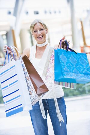 Woman with shopping bags at a shopping mall Stock Photo