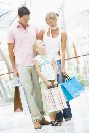 retail scene: Mother and father with young daughter at a shopping mall