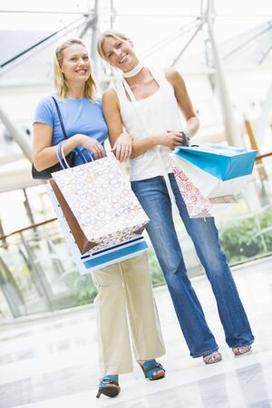 Two women at a shopping mall Stock Photo - 3197955