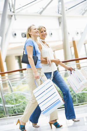 Two women at a shopping mall Stock Photo - 3197674