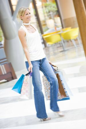 offset angles: Woman with shopping bags at a shopping mall Stock Photo