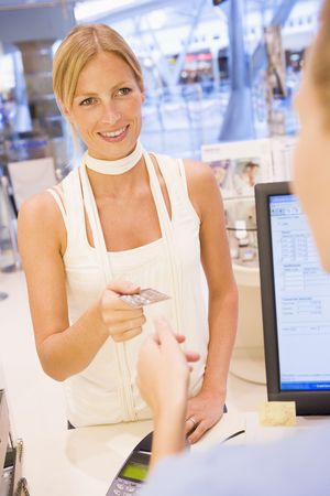 Woman paying for purchases with credit card photo