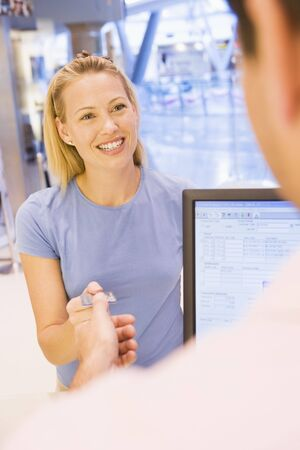 retail scenes: Woman paying for purchases with credit card Stock Photo