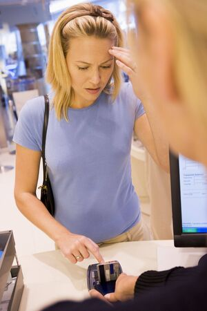 Woman trying to remember credit card PIN number photo
