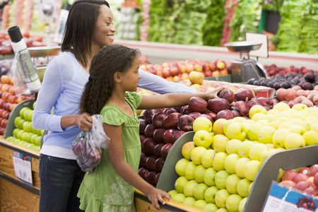 supermarket series: Woman and daughter shopping for apples at a grocery store