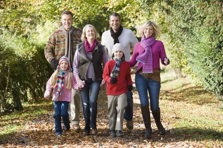 mature old generation: Family walking outdoors in park smiling