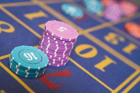 gambling parlour: Chips on a roulette table (selective focusclose up)