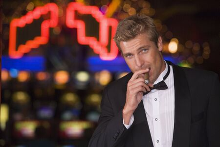 caucasoid race: Man in casino with cigar (selective focus) Stock Photo