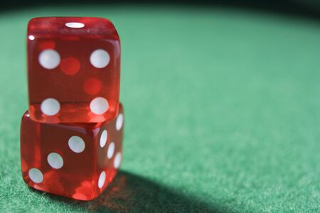 gambling parlour: Dice sitting on a poker table (close upselective focus)