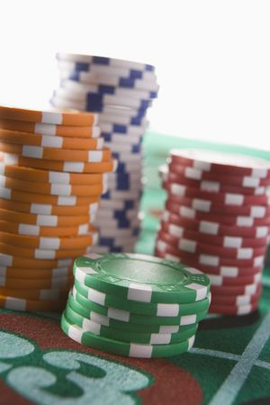 gambling parlour: Chips piled on a roulette table (close updepth of field) Stock Photo