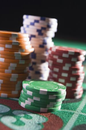 gambling parlors: Chips piled on a roulette table (close updepth of field) Stock Photo