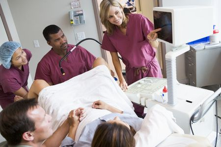 Doctor looking at monitor while retrieving eggs from ovary using vaginal ultrasound Stock Photo - 3203006