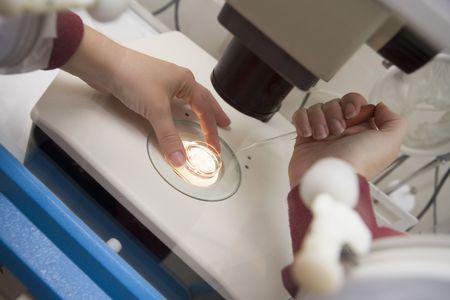Embryologist adding sperm to egg photo