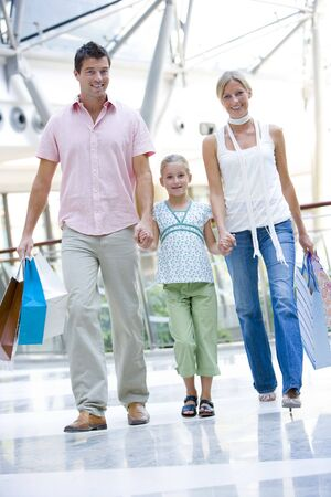shopping trip: Mother and father with young daughter at a shopping mall
