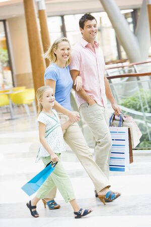 shopping scene: Mother and father with young daughter at a shopping mall
