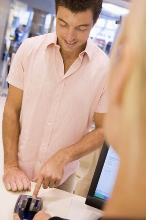 Man paying for purchases with credit card Stock Photo - 3198074
