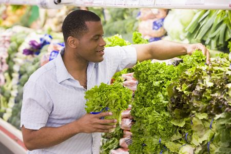supermarket series: Man shopping for lettuce at a grocery store