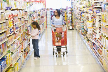 supermarket series: Mother and young daughter shopping at a grocery store