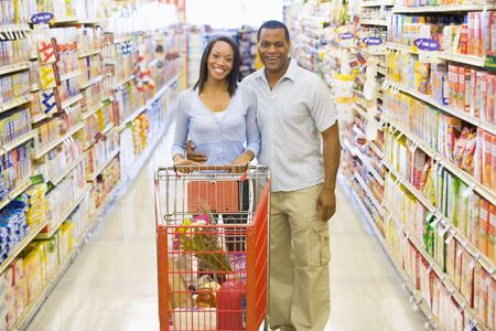 grocery store series: Young couple shopping at a grocery store