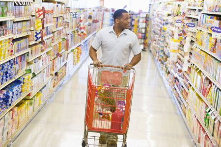 grocery cart: Man shopping at grocery store