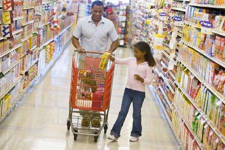 Father and daughter shopping at a grocery store photo