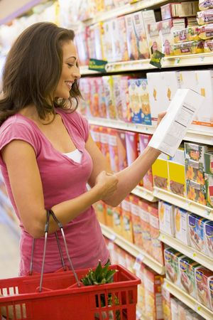 Woman shopping at a grocery store photo