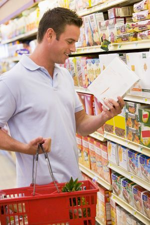 checking ingredients: Man shopping at grocery store