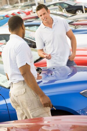 new car lots: Man shopping for a new car