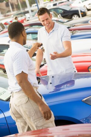 car dealers: Man shopping for a new car