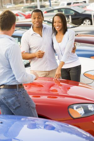 new car lots: Young couple shopping for a new car Stock Photo