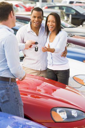 auto leasing: Young couple shopping for a new car Stock Photo